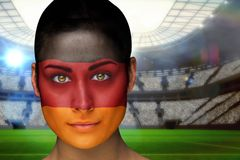 Composite image of beautiful germany fan in face paint Stock Images