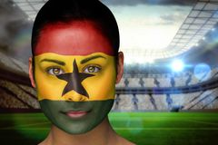 Composite image of beautiful ghana fan in face paint Royalty Free Stock Photos