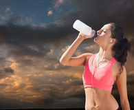 Composite image of beautiful healthy woman drinking water Stock Images