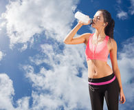 Composite image of beautiful healthy woman drinking water royalty free stock photos