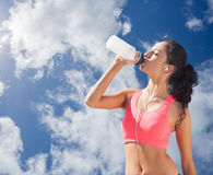Composite image of beautiful healthy woman drinking water Stock Photos