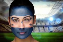 Composite image of beautiful honduras fan in face paint Stock Image