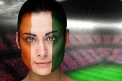 Composite image of beautiful ivory coast fan in face paint Stock Photos