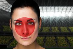 Composite image of beautiful japan fan in face paint Royalty Free Stock Image