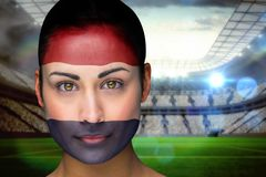 Composite image of beautiful netherlands fan in face paint Stock Images