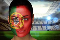 Composite image of beautiful portugal fan in face paint Stock Photos