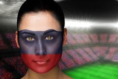 Composite image of beautiful russia fan in face paint Royalty Free Stock Photo