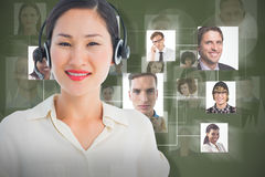 Composite image of beautiful smiling female executive with headset Royalty Free Stock Photos