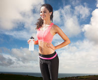 Composite image of beautiful smiling healthy woman holding water bottle stock photos