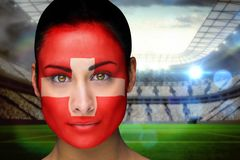 Composite image of beautiful swiss fan in face paint Royalty Free Stock Photos