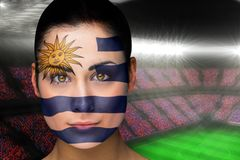 Composite image of beautiful uruguay fan in face paint Royalty Free Stock Photo