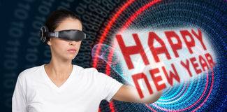 Composite image of beautiful woman gesturing while using virtual video glasses Stock Images