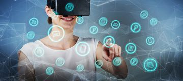 Composite image of beautiful woman imagining with virtual reality headset Stock Photo
