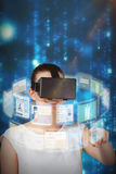Composite image of beautiful woman imagining with virtual reality headset 3d stock photo