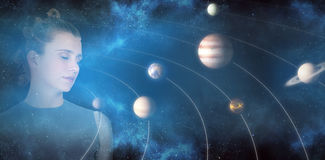Composite image of beautiful woman standing with closed eyes 3d. Beautiful woman standing with closed eyes against graphic image of various planets 3d Royalty Free Stock Photography