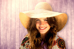 Composite image of beautiful woman with a straw hat Royalty Free Stock Photography
