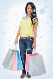 Composite image of beautiful woman student with shopping bags Stock Photography