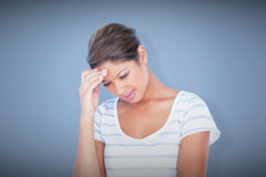 Composite image of beautiful woman suffering from headache Stock Image