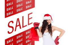 Composite image of beauty brunette in boxing gloves with shopping bag Royalty Free Stock Photos