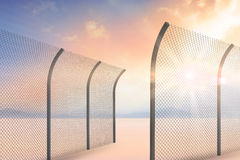 Composite image of bended chainlink fence 3d Royalty Free Stock Images