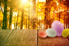 Composite image of big and small multi colored easter eggs Stock Photo