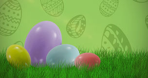 Composite image of big and small multi colored easter eggs Stock Images