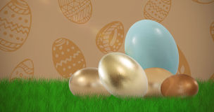 Composite image of big and small shiny easter eggs Royalty Free Stock Photo