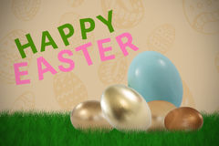 Composite image of big and small shiny easter eggs Stock Image