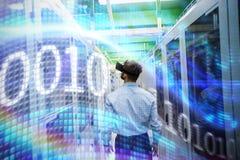 Composite image of binary code on digital screen stock photos