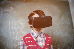 Composite image of black background with shades. Black background with shades against boy using a virtual reality device Stock Images