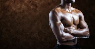 Composite image of black man Fitness Torso against brown background Stock Photo