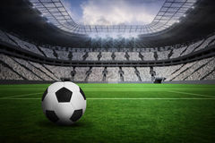 Composite image of black and white leather football Stock Images