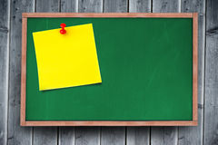 Composite image of blank yellow sticky note with thumbtack Stock Image