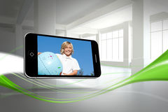 Composite image of blonde happy boy on smartphone screen Stock Photography