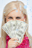 Composite image of blonde hiding her face with dollars banknotes Stock Photos