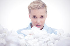 Composite image of blonde sick woman holding lots of tissues Stock Images