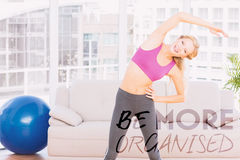 A Composite image of blonde smiling at camera while stretching Royalty Free Stock Photos