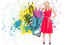 Composite image of blonde standing hand on hip Stock Photos
