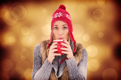 Composite image of blonde in winter clothes smiling at camera Stock Photos