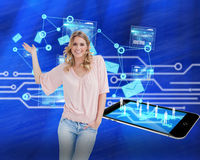 Composite image of blonde woman presenting something Royalty Free Stock Photos