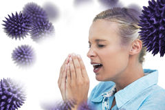 Composite image of blonde woman sneezing with hands in front of her face Stock Photo