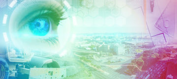Composite image of blue eye on female face. Blue eye on female face against overhead view of architect material Royalty Free Stock Images