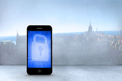 Composite image of blue lock on smartphone screen Royalty Free Stock Image