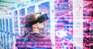 Composite image of blue and red technology interface. Blue and red technology interface against rear view of female technician using virtual reality headset Stock Images