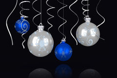 Composite image of blue and silver christmas baubles Royalty Free Stock Photo