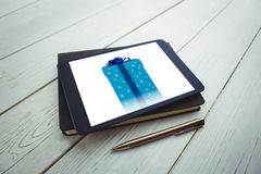 Composite image of blue and silver gift box Stock Photography