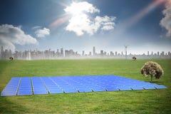 Composite image of blue solar panels. Blue solar panels against cityscape on the horizon stock illustration