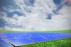 Composite image of blue solar panels. Blue solar panels against green field under blue sky royalty free illustration