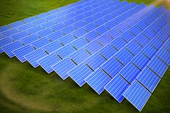 Composite image of blue solar panels. Blue solar panels against landscape with trees against sky vector illustration