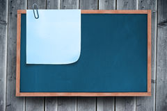Composite image of blue sticky note with paper clip Royalty Free Stock Images